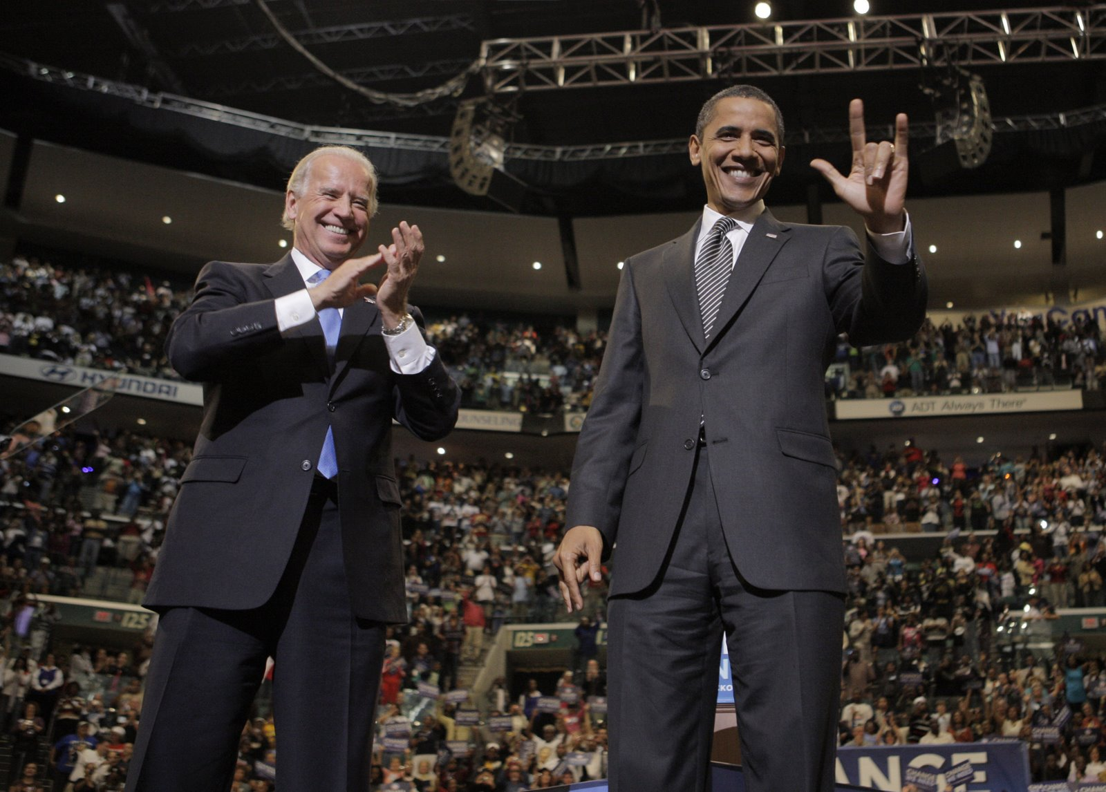 Democratic presidential candidate Sen. Barack Obama, D-Ill., right, flashes a sign as he is joined by his vice presidential running mate Sen. Joe Biden, D-Del., at a rally in Sunrise, Fla., Wednesday, Oct. 29, 2008. (AP Photo/Jae C. Hong)